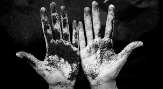 Hands covered in ash and dirt.
