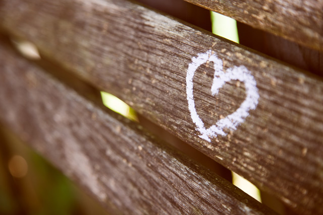 A heart etched on a wooden fence.