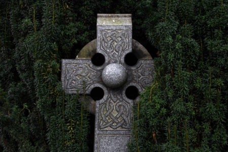 A Celtic cross made of stone.