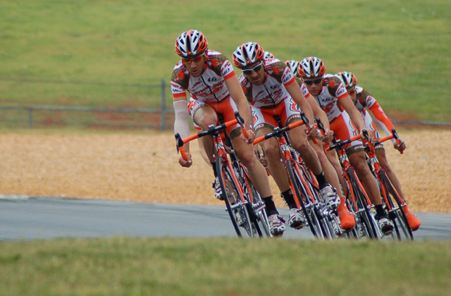A team of cyclists racing together.