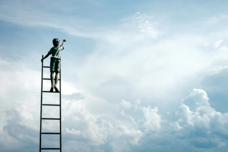 A boy on a ladder going up to the clouds.