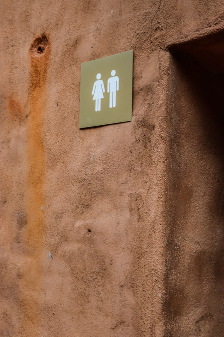 A sign for a public restroom.