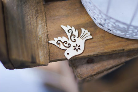 A cutout of a dove, a symbol of peace.