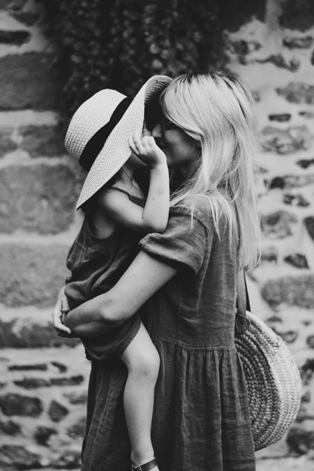 A mother holding her little daughter.