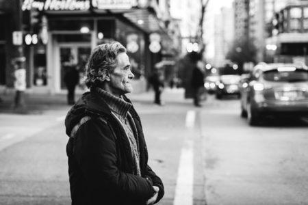 A man looking across a city street.