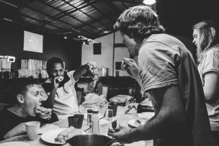 People eating together.