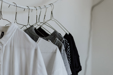 Clothes on hangers.