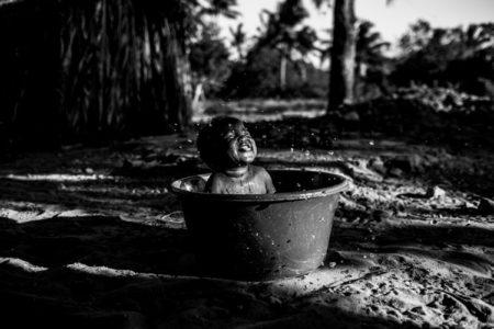 A baby in a small bathtub