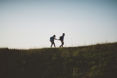 a couple hiking while holding hands