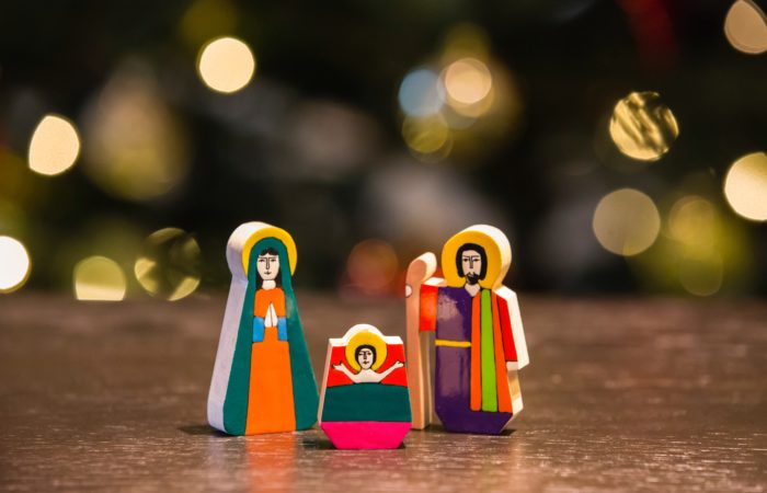 Nativity figures of Jesus, Mary, and Joseph with halos