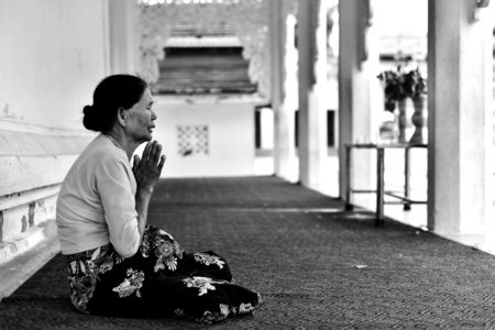 Woman praying in the temple