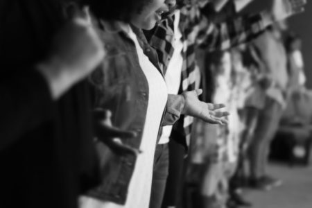 Black and white photo of choir members worshipping