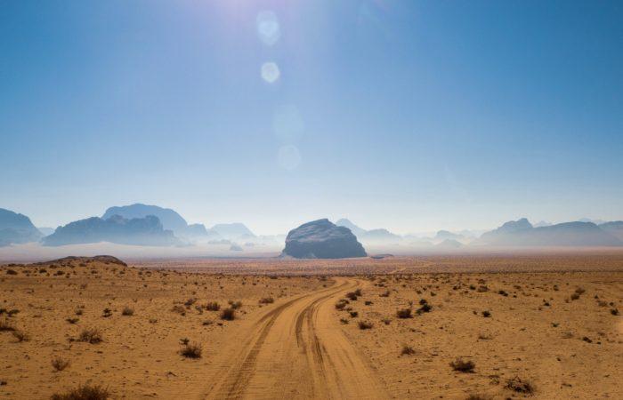 The sun shining down on a desert landscape