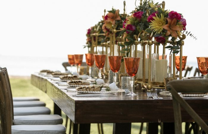 A table set for dinner with many places