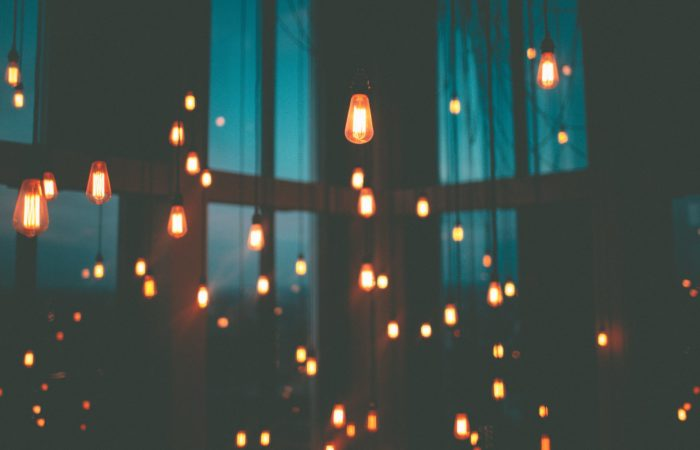 a room full of brightly shinning lights hanging from the ceiling