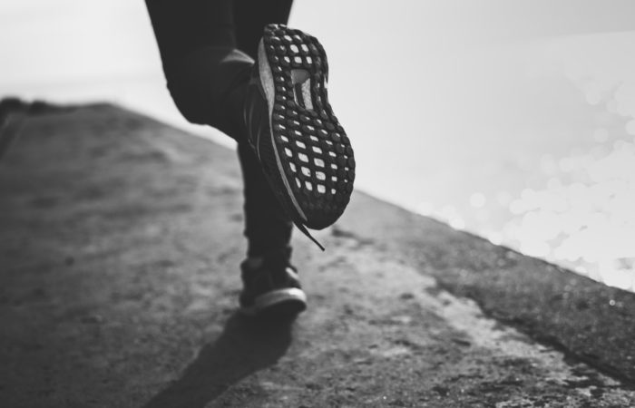 Black and white image of a person running