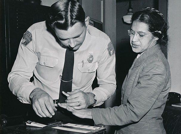 Rosa Parks being fingerprinted