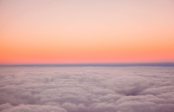 A view of the sunset horizon from above the clouds