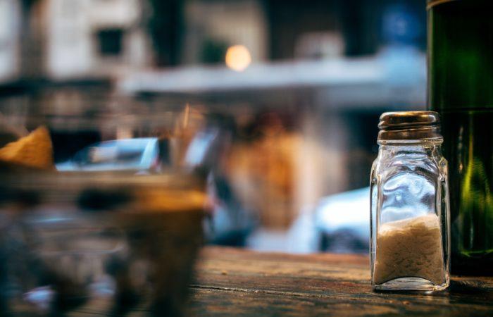 A salt shaker on a counter