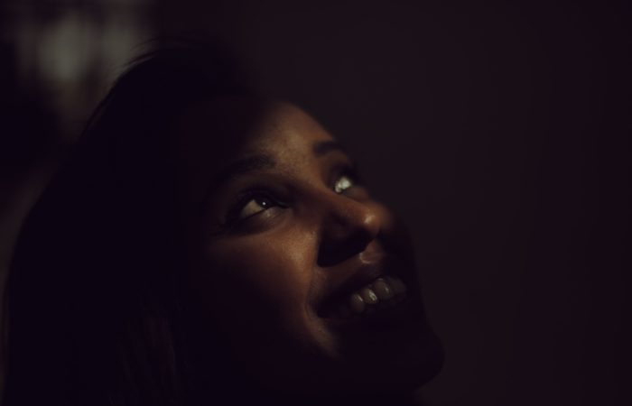 a woman looking up into a shadowy light