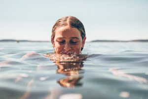 A woman submerged in clear water