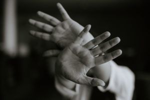 Black and white images of hands blocking the camera