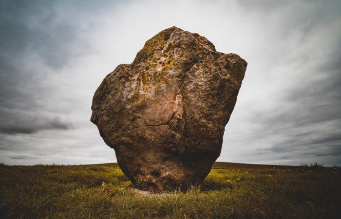 a giant rock in a field