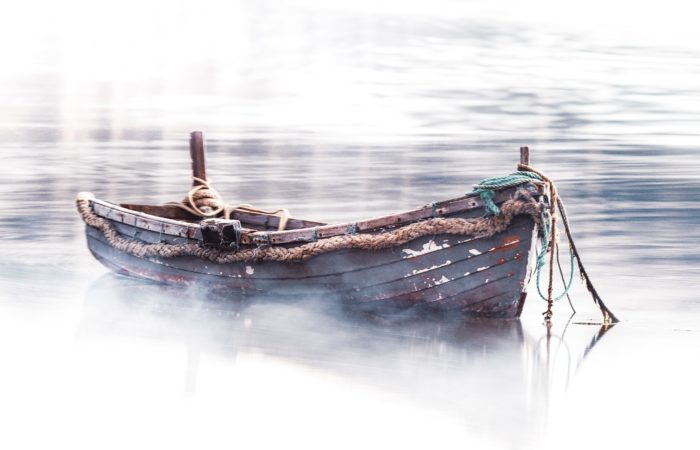 an empty rowboat on water