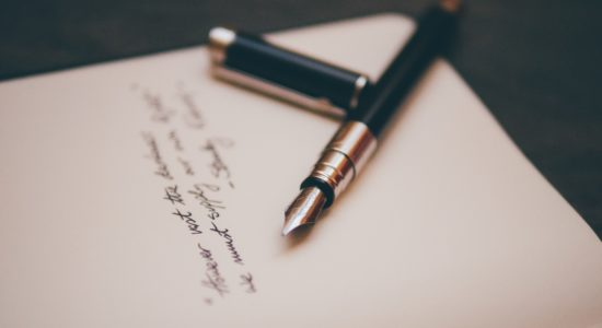 A fountain pen and a letter