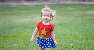 A toddler in a Wonder Woman outfit