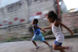 two kids running, racing each other