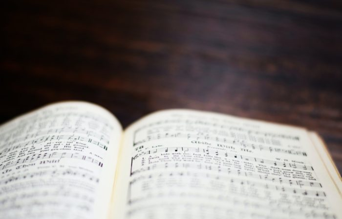 "hymnal open to ""Abide With Me"""