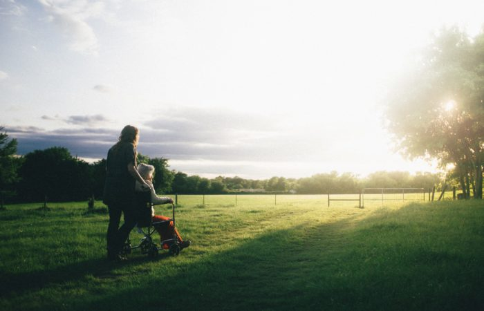A young woman and an older woman looking at a sunrise