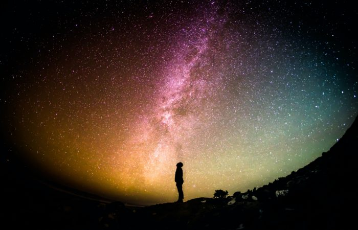 A person looking up at the aurora borealis