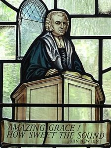 Stained glass image of John Newton