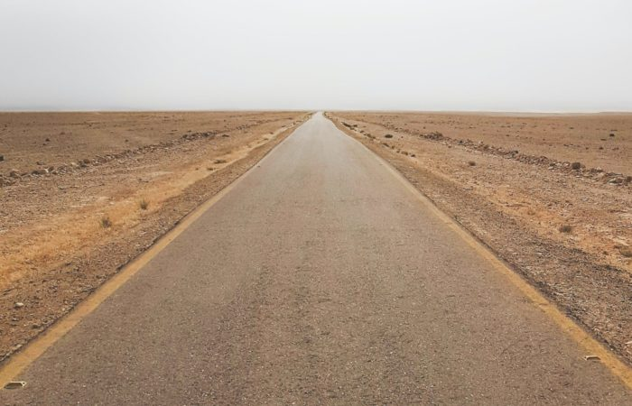 An empty road stretching off into the desert