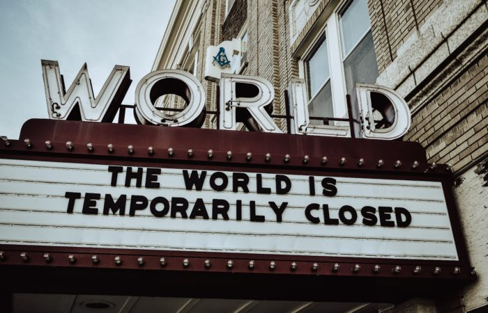"A movie marquee that says ""The world is temporarily closed"""