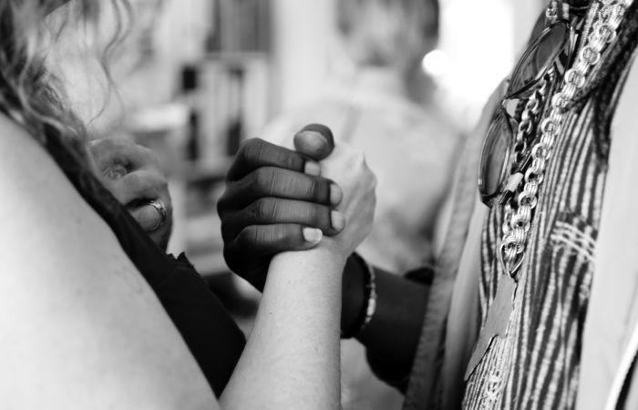 A white woman and African American man holding hands