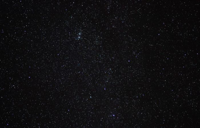 A dark night sky full of stars