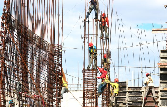 Construction workers working on a building