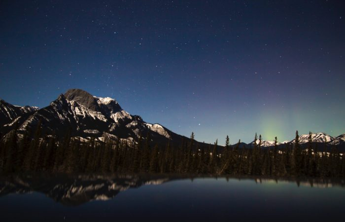 Starry sky over a mountain and a lake