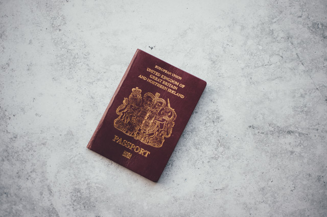 A red United Kingdom passport