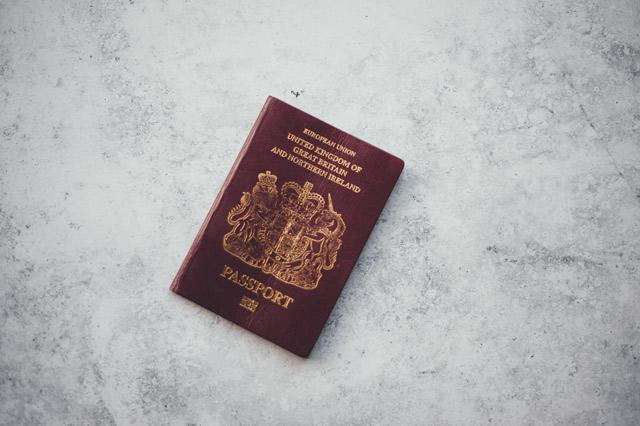 A red United Kingdom passport