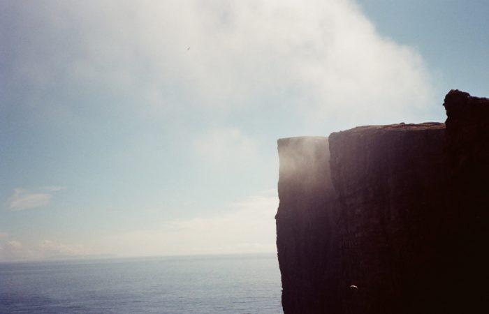 A cliff overlooking an ocean
