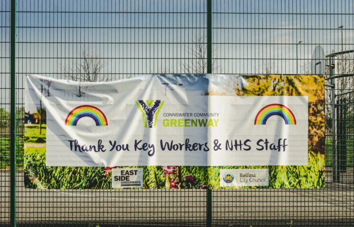 """A sign on a garden in Belfast, Ireland, decorated with rainbows and reading """"Thank you key workers and NHS staff"""""""