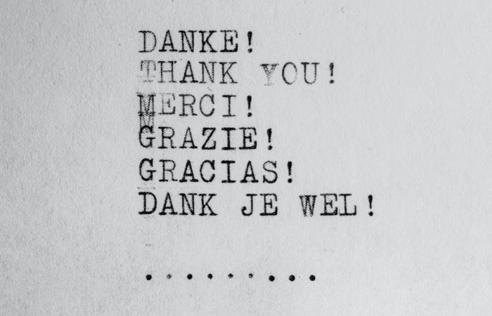 "A sign with the words ""Thank you"" in German, English, French, Italian, Spanish, and Dutch"