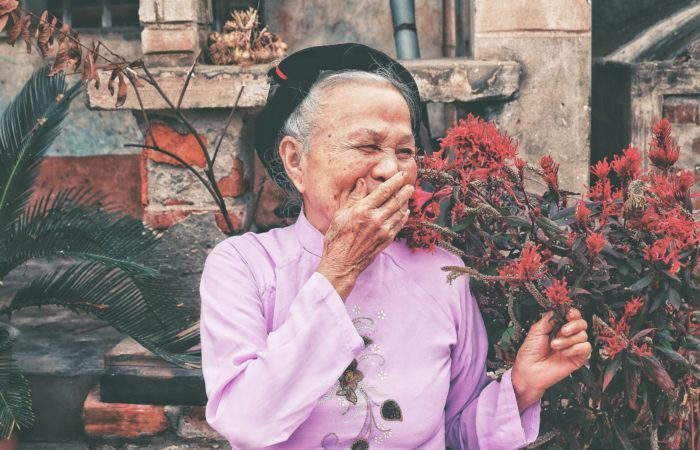 A woman heartily laughing