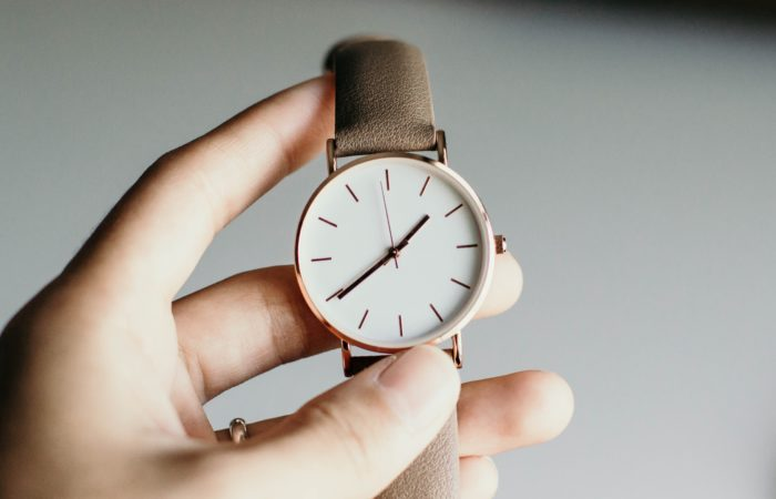 A person holding a watch