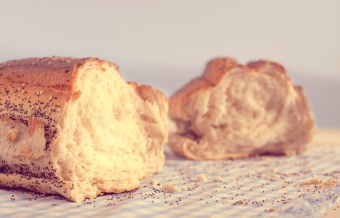 A loaf of artisan bread sliced in half
