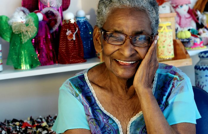 A smiling elderly woman in a store